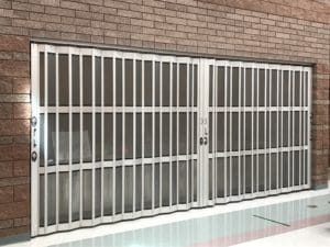 Side folding security doors