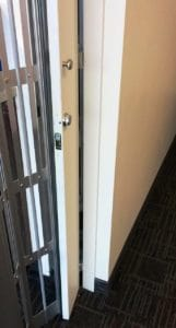 Pocket door frame with lock